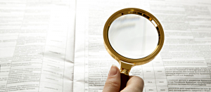 magnifying-glass-documents